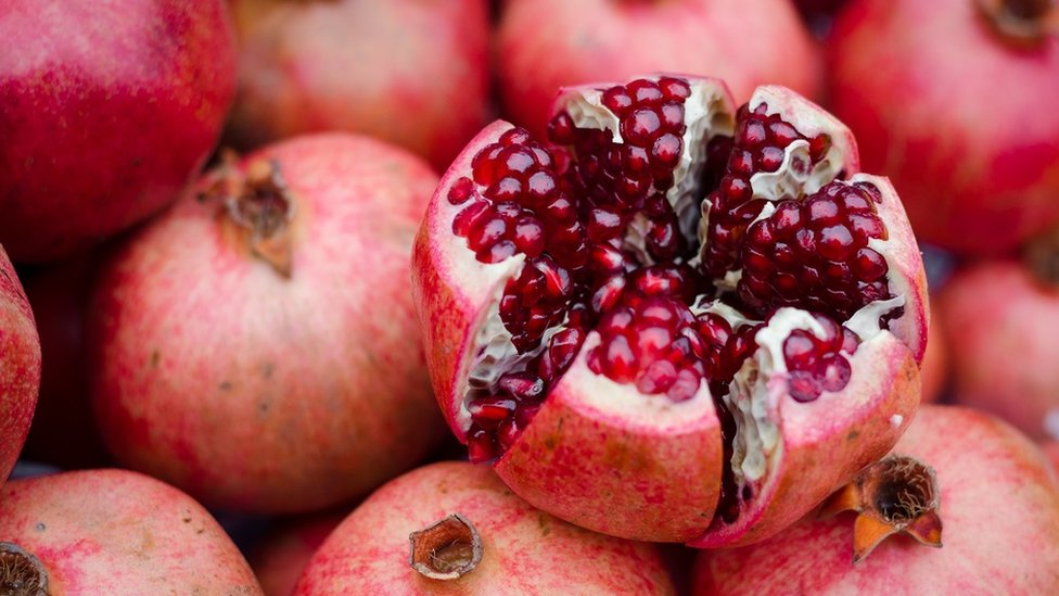 Close up of an open pomegranate.